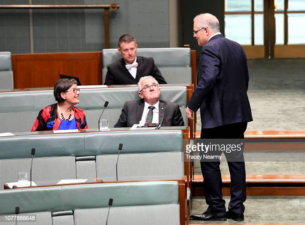 Prime Minister Scott Morrison speaks to the Member for Indi Cathy McGowan and the Member for Denison Andrew Wilkie in the House of Representatives at...