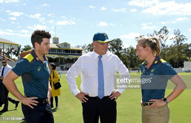 Prime Minister Scott Morrison speaks with Australian Cricket captains Tim Paine and Meg Lanning during the media announcement that the Federal...