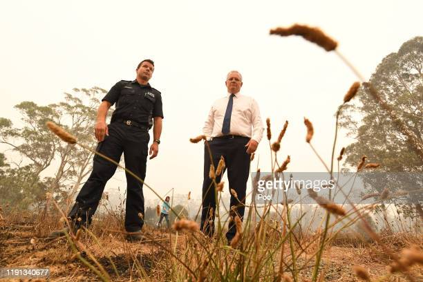 Prime Minister Scott Morrison tours the Wildflower farm owned by Paul and Melissa Churchman on January 3 2020 in Sarsfield Victoria Australia People...
