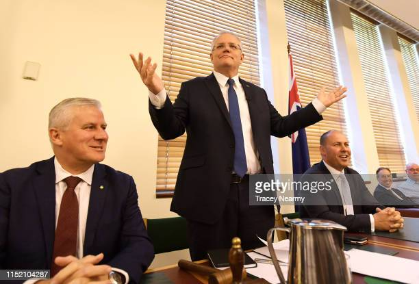 Prime Minister Scott Morrison waves to his ministers with the Deputy Prime Minister Michael McCormack and Deputy Leader of the Liberal Party Josh...