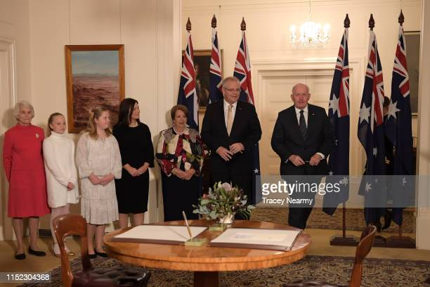 Prime Minister Scott Morrison wife Jenny Morrison and Australia's GovernorGeneral Sir Peter Cosgrove attend the swearingin ceremony at Government...