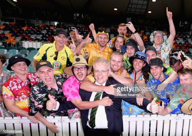 Prime Minister Scott Morrison with fans after Australia won the One Day International warm up match between the PM's XI and South Africa at Manuka...