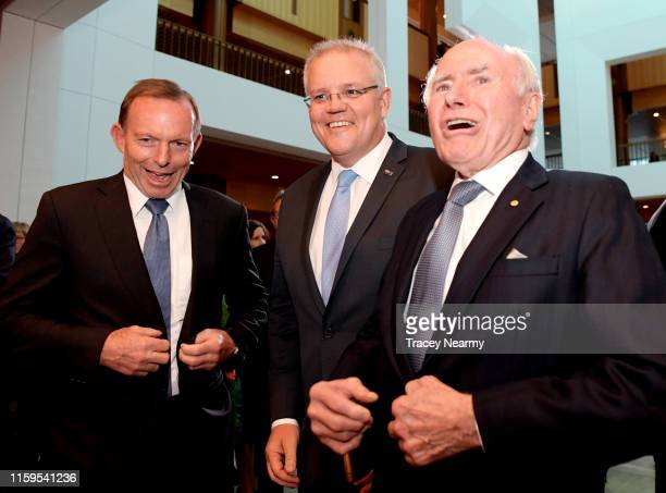 Prime Minister Scott Morrison with former Prime Ministers Tony Abbott and John Howard after leaving the Senate at Parliament House on July 02 2019 in...