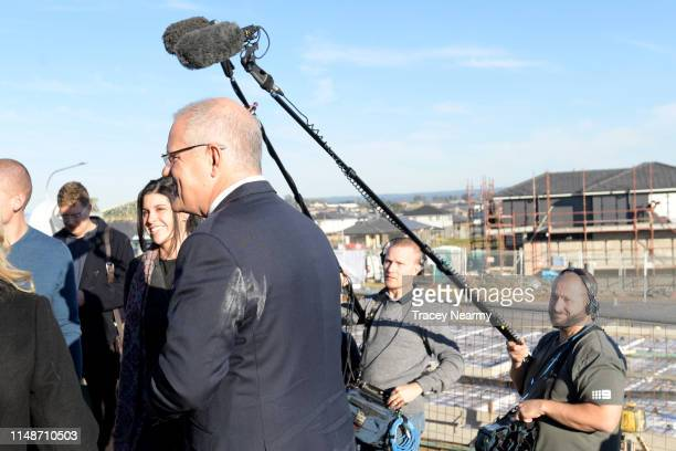 Prime Minister Scott Morrison with paint on his suit as he visits a houseing estate in Caddens the seat of Lindsay during the federal election on May...