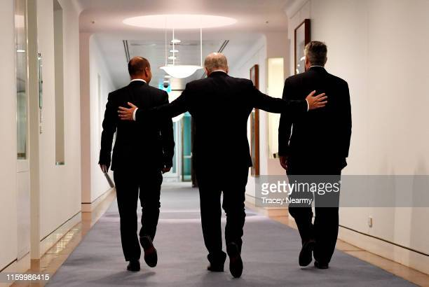 Prime Minister Scott Morrison with Treasurer Josh Frydenberg and Senator Mathias Cormann walk out of press conference after the passing of the...