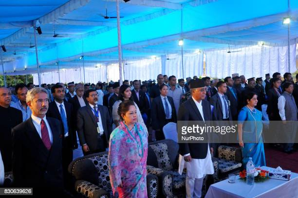 Prime Minister Sher Bahadur Deuba and External Affairs Minister of India Sushma Swaraj stands as the National anthem plays during reception hosted at...