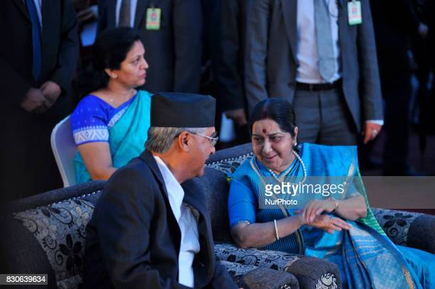 Prime Minister Sher Bahadur Deuba and External Affairs Minister of India Sushma Swaraj talks with each other during reception at India House to mark...
