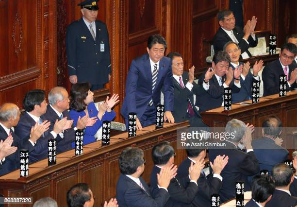 Prime Minister Shinzo Abe acknowledges the applause after his reelection during the Lower House plenary session at the Diet Building on November 1...