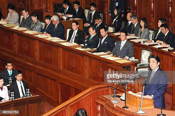 Prime Minister Shinzo Abe addresses in answering to the question by the Democratic Party of Japan lawmaker Seiji Maehara during the plenary session...