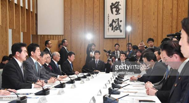 Prime Minister Shinzo Abe addresses Japan' efforts to help achieve UN sustainable development goals at a meeting convened at his office in Tokyo on...