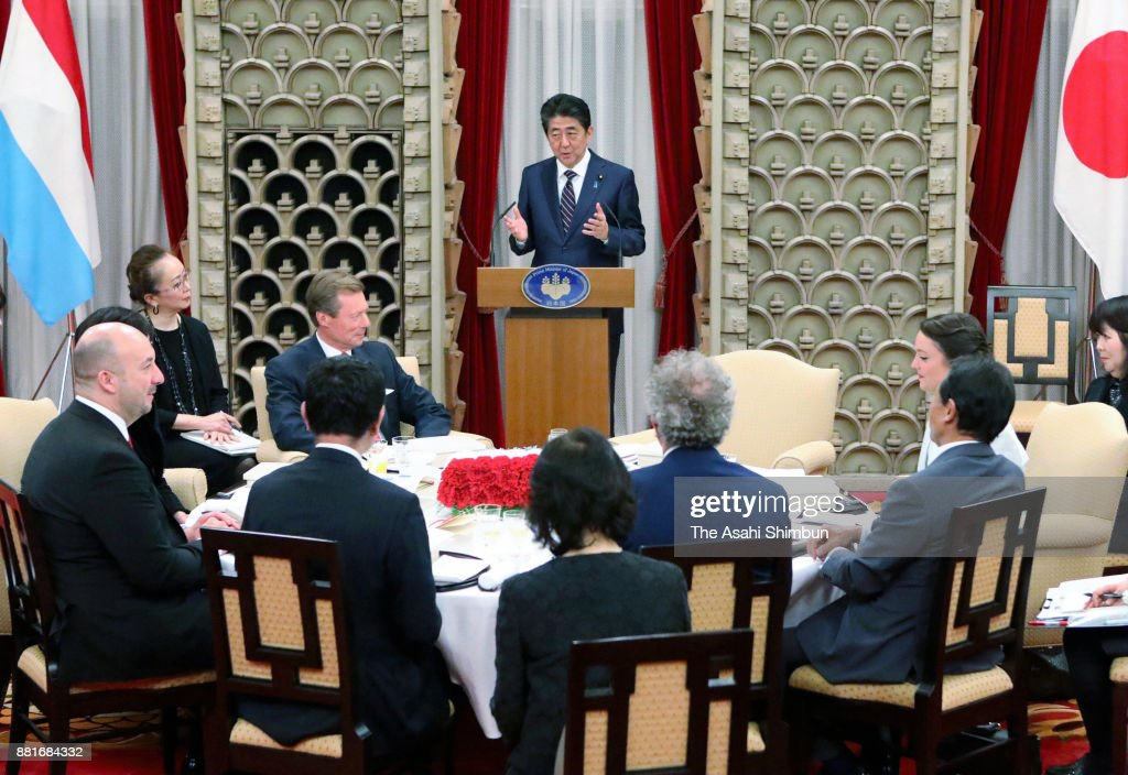 Prime Minister Shinzo Abe addresses while Grand Duke Henri of Luxembourg listens during their dinner at the prime minister's official residence on November 28, 2017 in Tokyo, Japan.