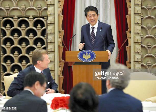 Prime Minister Shinzo Abe addresses while Grand Duke Henri of Luxembourg listens during their dinner at the prime minister's official residence on...