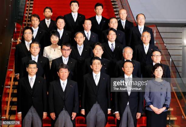 Prime Minister Shinzo Abe and his new cabinet members pose for photographs at the prime minister's official residence on August 3, 2017 in Tokyo,...