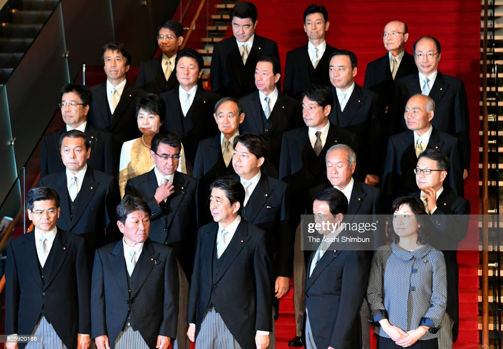 Prime Minister Shinzo Abe (front row, C) and his new cabinet members pose for photographs at the prime minister's official residence on August 3, 2017 in Tokyo, Japan. Prime Minister Shinzo Abe reshuffles his Cabinet appointing ministers from outside his close circle of political allies in a bid to halt declining support ratings.