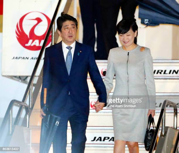 Prime Minister Shinzo Abe and his wife Akie are seen on arrival at Haneda International Airport on September 22 2017 in Tokyo Japan