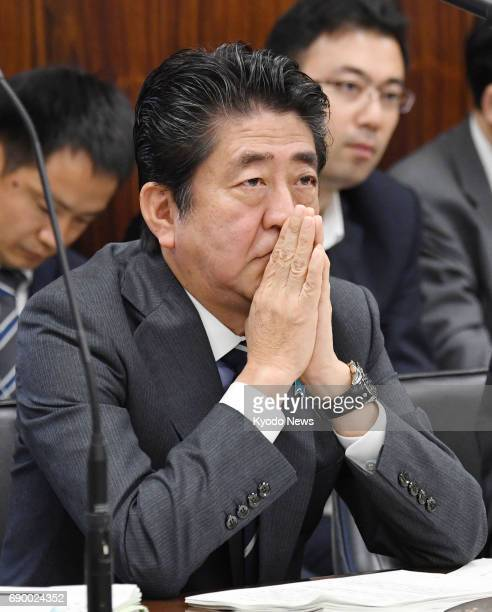 Prime Minister Shinzo Abe attends an upper house judicial affairs committee session in Tokyo on May 30 during which it was examined whether Abe was...