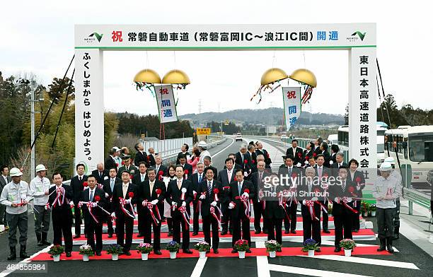 Prime Minister Shinzo Abe attends the ceremony to celebrate the entire Joban Expressway opening on March 1 2015 in Tomioka Fukushima Japan Local...