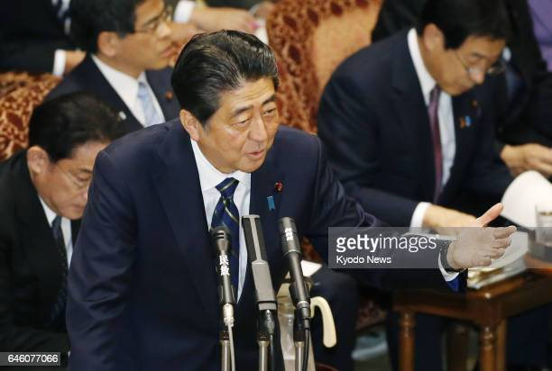 Prime Minister Shinzo Abe attends the House of Councillors budget committee session in Tokyo on Feb 28 a day after the House of Representatives...
