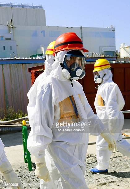 Prime Minister Shinzo Abe in red helmet is seen during his inspection at the Tokyo Electric Power Co Fukushima Daiichi nuclear power plant on...