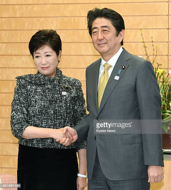 Prime Minister Shinzo Abe meets with Tokyo Gov Yuriko Koike at his office in Tokyo on Jan 10 2017 Koike told reporters after the meeting the two...