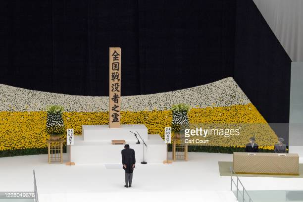 Prime Minister Shinzo Abe of Japan, bows during a memorial service marking the 75th anniversary of Japan's surrender in World War II at the Nippon...