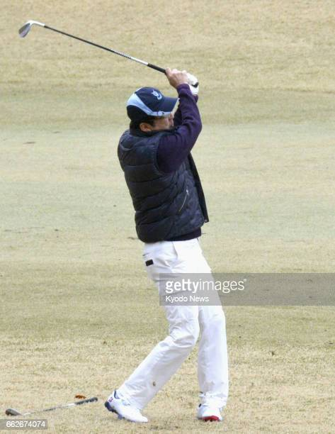 Prime Minister Shinzo Abe plays a shot during a round of golf with business leaders in Tokyo on April 1 the first time since he played with US...