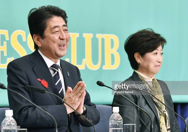 Prime Minister Shinzo Abe president of the ruling Liberal Democratic Party and Tokyo Gov Yuriko Koike leader of the newly formed Party of Hope attend...