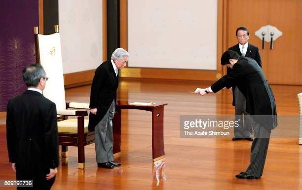 Prime Minister Shinzo Abe receives the appointment letter from Emperor Akihito during the attestation ceremony at the prime minister's official...