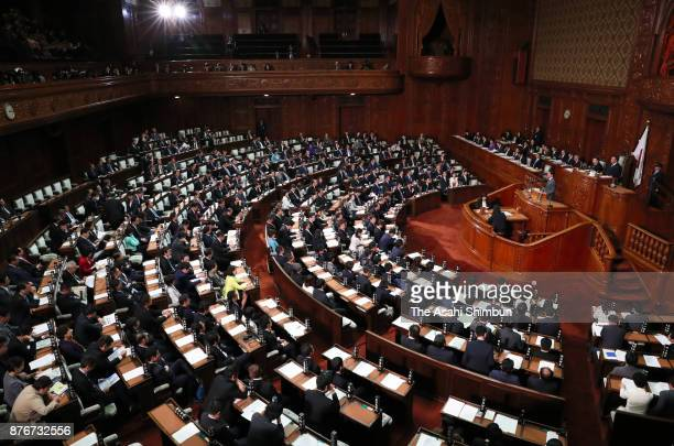 Prime Minister Shinzo Abe responds a question during the party leaders' question at the Lower House plenary session at the Diet building on November...