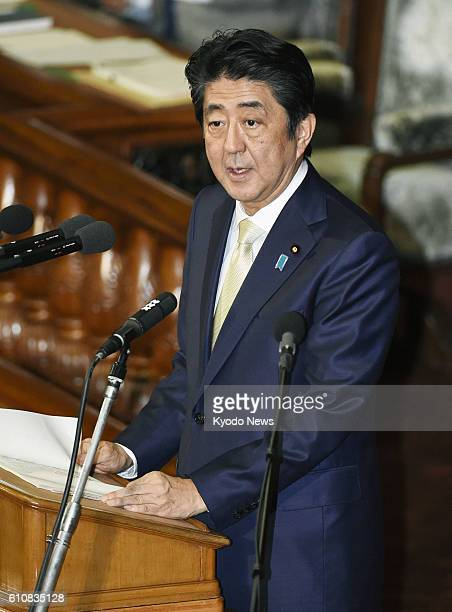 Prime Minister Shinzo Abe speaks at a House of Representatives plenary session in Tokyo on Sept 28 2016 Abe called for public debates on...