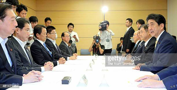 Prime Minister Shinzo Abe speaks during a new national stadium construction replaning meeting at his official residence on July 21 2015 in Tokyo...