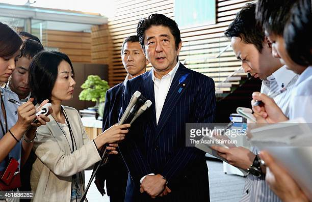 Prime Minister Shinzo Abe speaks to the media reporters at his official residence on July 3 2014 in Tokyo Japan Japan will partially lift economic...