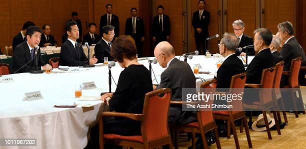 Prime Minister Shinzo Abe talks with ABomb survivors after attending the Peace Memorial Ceremony on August 6 2018 in Hiroshima Japan The first atomic...