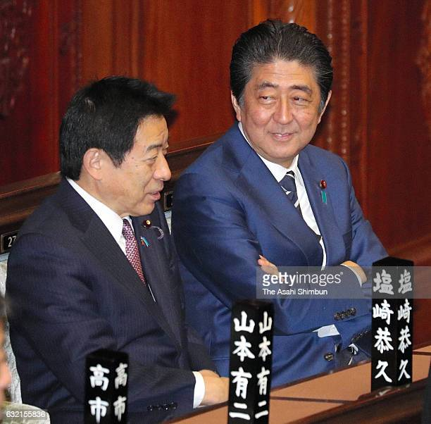 Prime Minister Shinzo Abe talks with veteran lawmaker Yasuhisa Shiozaki prior to a Lower House plenary session as the 194rd ordinary session of the...