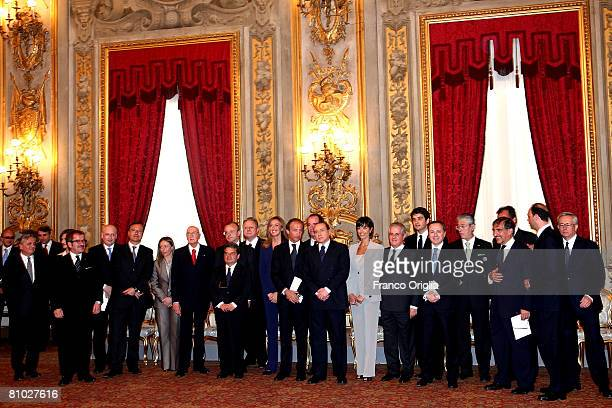 Prime Minister Silvio Berlusconi and Italian President Giorgio Napolitano pose for the family picture during the swearing in ceremony for the new...