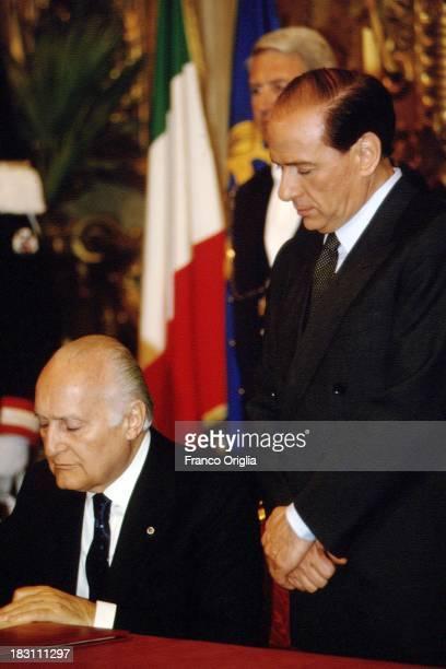 Prime Minister Silvio Berlusconi and President of the Italian Republic Oscar Luigi Scalfaro attend the inauguration of the first government of...