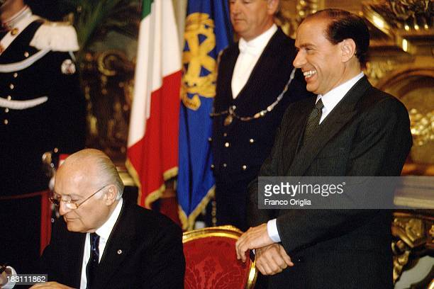 Prime Minister Silvio Berlusconi and President of the Italian Republic Oscar Luigi Scalfaro attend the inauguration of the first government of...