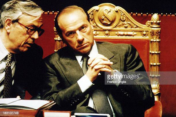 Prime Minister Silvio Berlusconi chats with Cesare Previti at the Italian Senate during a vote of confidence for Berlusconi's government at Palazzo...