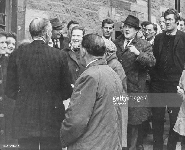 Prime Minister Sir Alec DouglasHome sharing a joke with his opponent William Rushton as the pair meet in front of a crowd during the Kinross and West...