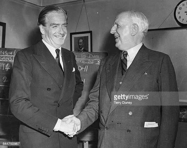 Prime Minister Sir Anthony Eden shaking hands with Lord Woolton Chairman of the Conservative Party after their party victory in the polls May 27th...