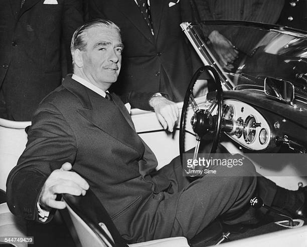 Prime Minister Sir Anthony Eden sitting at the wheel of the AustinHealey 100 sports car at the opening of the Motor Show at Earls Court London...