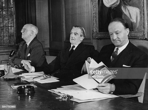 Prime Minister Sir Anthony Eden smoking a cigarette with Chancellor Rab Butler reading the party manifesto at a press conference at Church House...