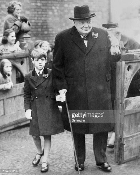 Prime Minister Sir Winston Churchill smiles after attending the christening of his youngest granddaughter Charlotte Clementine Soames at Westerham...