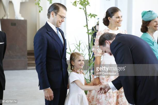 Prime Minister Stefan Loefven shakes hands with Princess Estelle standing between Crown Princess Victoria and Prince Daniel during a reception in the...