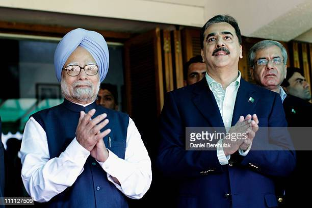Prime Minister Syed Yusuf Raza Gilani of Pakistan and Prime Minister Manmohan Singh of India applaud the players prior to the start of the 2011 ICC...