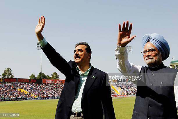 Prime Minister Syed Yusuf Raza Gilani of Pakistan and Prime Minister Manmohan Singh of India wave to spectators prior to the start of the 2011 ICC...