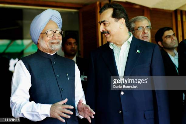 Prime Minister Syed Yusuf Raza Gilani of Pakistan and Prime Minister Manmohan Singh of India converse prior to the start of the 2011 ICC World Cup...