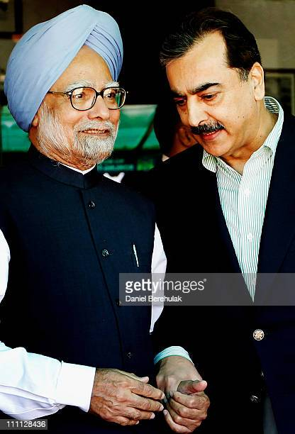Prime Minister Syed Yusuf Raza Gilani of Pakistan and Prime Minister Manmohan Singh of India hold hands as they converse prior to the start of the...