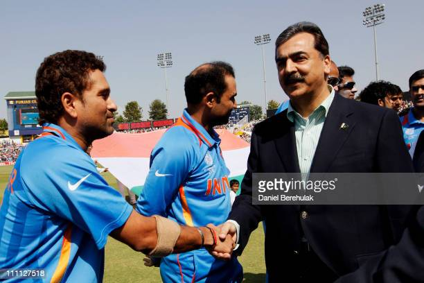 Prime Minister Syed Yusuf Raza Gilani of Pakistan shakes hands with Sachin Tendulkar of India prior to the start of the 2011 ICC World Cup second...