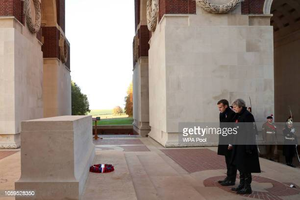 Prime Minister Theresa May and French President Emmanuel Macron attend a wreath-laying ceremony at Thiepval Memorial on November 09, 2018 in...